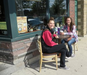 photo by Cori Hilsgen Maria Kiminski (left) and Amy Kiminski enjoyed a sisterly chat in front of the Local Blend Sept. 13. Maria Kiminski is a sophomore at the College of St. Benedict studying elementary education. Amy Kiminski graduated from CSB last year and was visiting for the weekend. The two are from Farmington and planned to attend a soccer game that afternoon. Maria Kiminski said St. Joseph is a great place and it is moments like their time spent together that make it special.