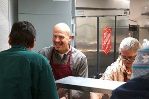 contributed photo Bob Ringstrom, Sartell businessman, serves a diner at the Salvation Army recently. Ringstrom and Ramon Navarro, owner of Anejos Mexican restaurant in Sartell, teamed up to put on a big Mexican meal as part of the Salvation Army's Philanthro Feed program.