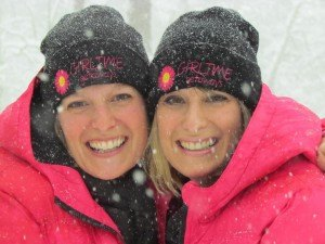 contributed photo Michelle Levin (left) and Marci Turenne-Hansen are twin sisters who founded a successful business called GirlTime Getaways on which they – and their clients – have a blast enjoying surprises on their mystery trips.