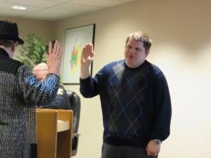 photo by Logan Gruber New council member Matt Killam takes his oath of office at Monday night's city council meeting, given by City Administrator Judy Weyrens.