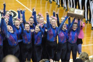 contributed photo Sartell Sabre dancers hoist high their award after winning the high-kick championship at Target Center Feb. 14.