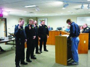 photo by Logan Gruber Mayor Schultz swore the new reserve officers into service during the Feb. 2 city council meeting.