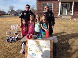 contributed photo Friends Lydia Woehl, Sophia Woehl, Megan Mahowald and Ava Radeke were surprised at the success of their March 15 lemonade stand. They were visited by more than 30 customers, including Sartell Police Officers Jacob Walters and Kari Bonfield. Lydia Woehl is 5. The others are 9. All of them go to Pine Meadow Elementary.