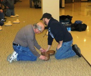photo by Cori Hilsgen Instructors Bob Kempenich (left) and Mike Hengel demonstrate cardiopulmonary resuscitation and mouth-to-mouth breathing on a manikin during a recent Bystander CPR class at Heritage Hall. Both are sudden-cardiac-arrest survivors.