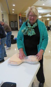 photo by Cori Hilsgen Church of St. Joseph Health and Wellness Minister Marjorie Henkemeyer practices on a manikin during a Bystander CPR class.
