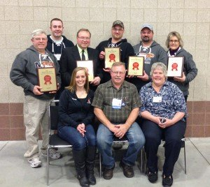 contributed photo St. Joseph Meat Market employees and owners Harvey and Carol Pfannenstein hold the awards they received at the 75th annual convention of the Minnesota Association of Meat Processors. Shown are (front row, left to right) Wendy Theisen, Harvey and Carol Pfannenstein; (back row) Rich, Dan and Cy Pfannenstein, Jesse Stueve, Roger Rudnicki and Alice Mayers.