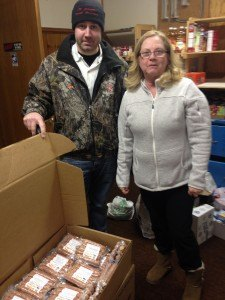 contributed photo Dan Pfannenstein drops off four boxes of meat product, made in the St. Joseph Meat Market sausage kitchen during the MAMP pre-convention, to St. Joseph Food Shelf coordinator Ann Scherer.
