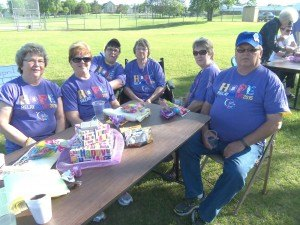 "photo by Dennis Dalman At the Relay for Life rally June 5, a walking team named ""Fightin' Chicks"" relaxes before beginning their relay walk. The team raised the third-highest amount of money at the event of the 27 teams – $4,004. It's comprised of (left to right) Judy Braegelmann of Waite Park, Jareet Kaproth of St. Cloud, Lori Zipp of Sauk Rapids, Sharon Skuza of Sauk Rapids, Doreen Unterberger of St. Cloud and Tom Skuza of Sauk Rapids. Sharon and Tom are married. Kaproth is Tom's cousin, Braegleman is Tom's sister-in-law, and Zipp is Tom's younger sister."