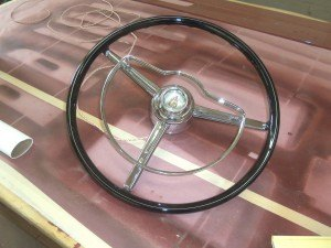 photo by Dennis Dalman The original steering wheel of the 1957 Chris Craft boat will soon be re-attached to the boat.