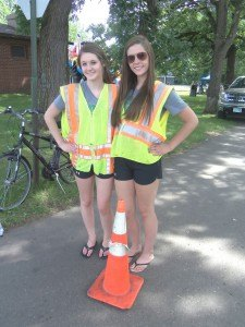 Brea Timlin (left) and Brittany Bodell worked as traffic directors at River Days Food Fest June 27 in Sauk Rapids. As members of the Sauk Rapids Dance Team, they worked to raise money for their team.