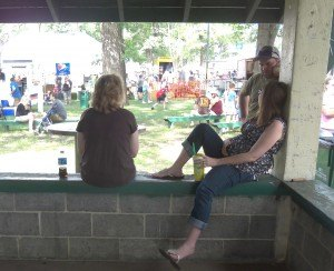 photo by Dennis Dalman Three friends share a lazy-day chat in the shade at River Days Food Fest.