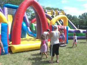 photo by Dennis Dalman Children have a blast on the inflatables at River Days Food Fest.